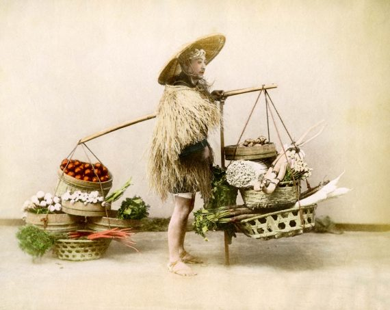 010 Vegetable seller in straw raincoat