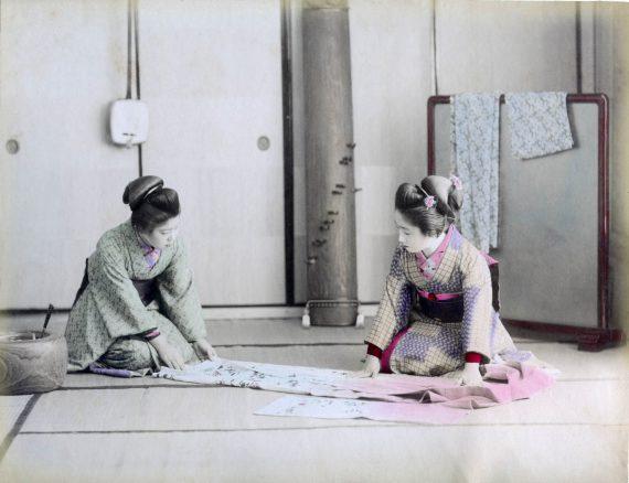 022 Two women folding a kimono